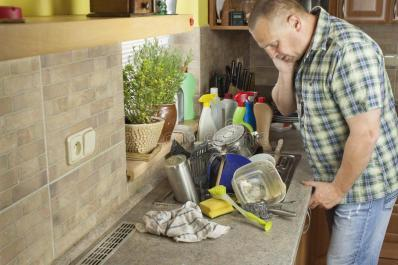 man-washing-dirty-dishes-kitchen-sink-domestic-cleaning-up-party-55570729